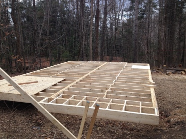Main deck, fully framed. The plywood areas are the bathroom and the entryway, where there will eventually be tile.